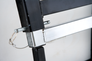 Undo the locking pins located on all four corners of the outer chrome extendable crossbar legs.